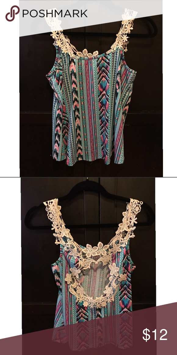 Beauty pattern lace top Multi color tank top with lace detailing. Great to dress up or down. Worn once! Excellent condition! **Not Fashion Nova** Fashion Nova Tops Tank Tops