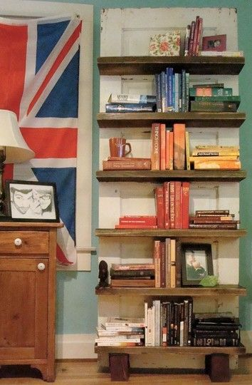 DIY Bookshelf, Old Door, Books cataloged by color. Lovely.