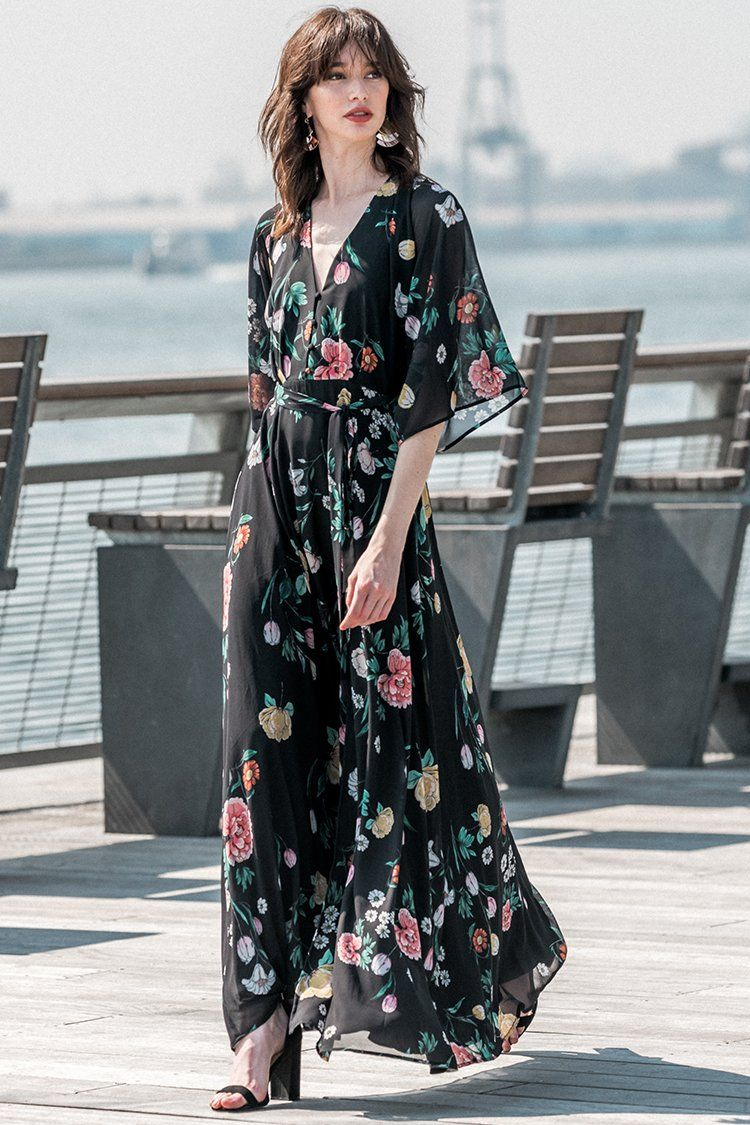 bb0f1a6747f7d9 Details include kimono sleeves, a deep v neckline with button detail,  flowing maxi skirt with side slit and self-tie belt.