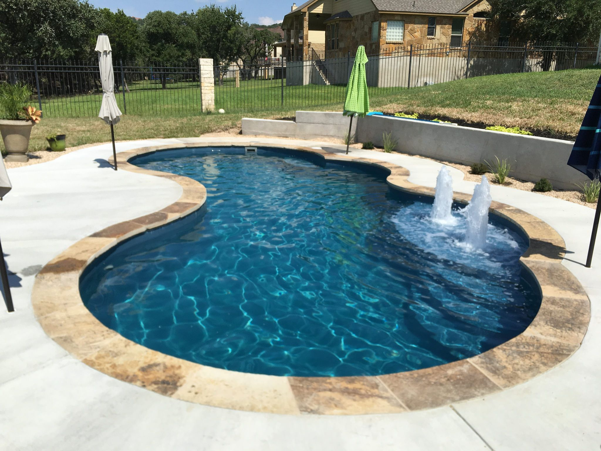 This 16 X 32 Gemini Shaped Fibergl Inground Pool Complete In Vega Color Sandstone Coping And Bubblers Is Perfect For Your Backyard Upgrade