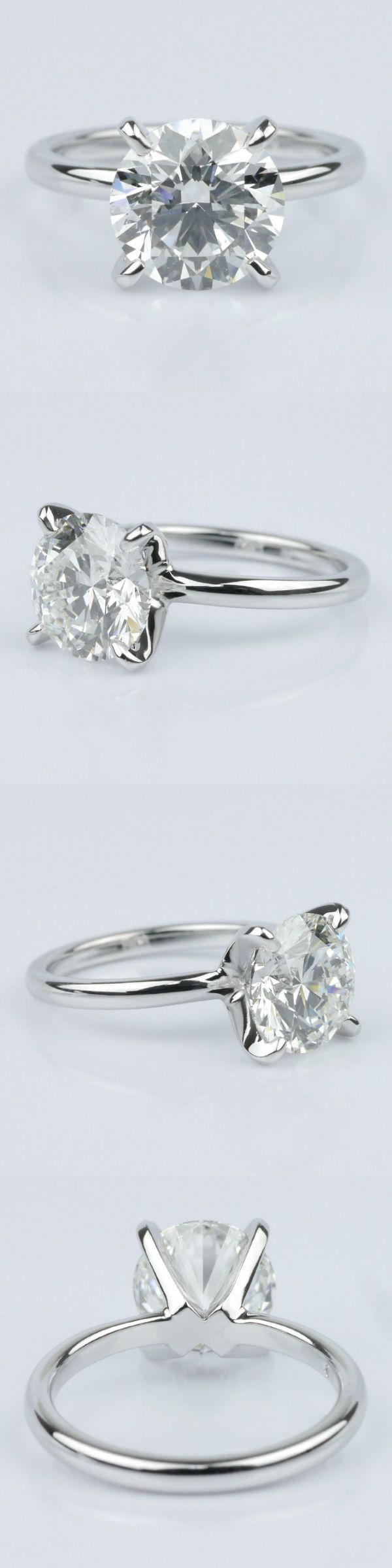 Classic Platinum Solitaire Engagement Ring (2.30 ct.) Round 2.30 Ctw. Color: F Clarity: SI1 Cut: Super Ideal Certification: GIA Diamond/Gem Cost: $24,650 Round Loose Diamond Metal: Platinum Setting Cost: $2,642