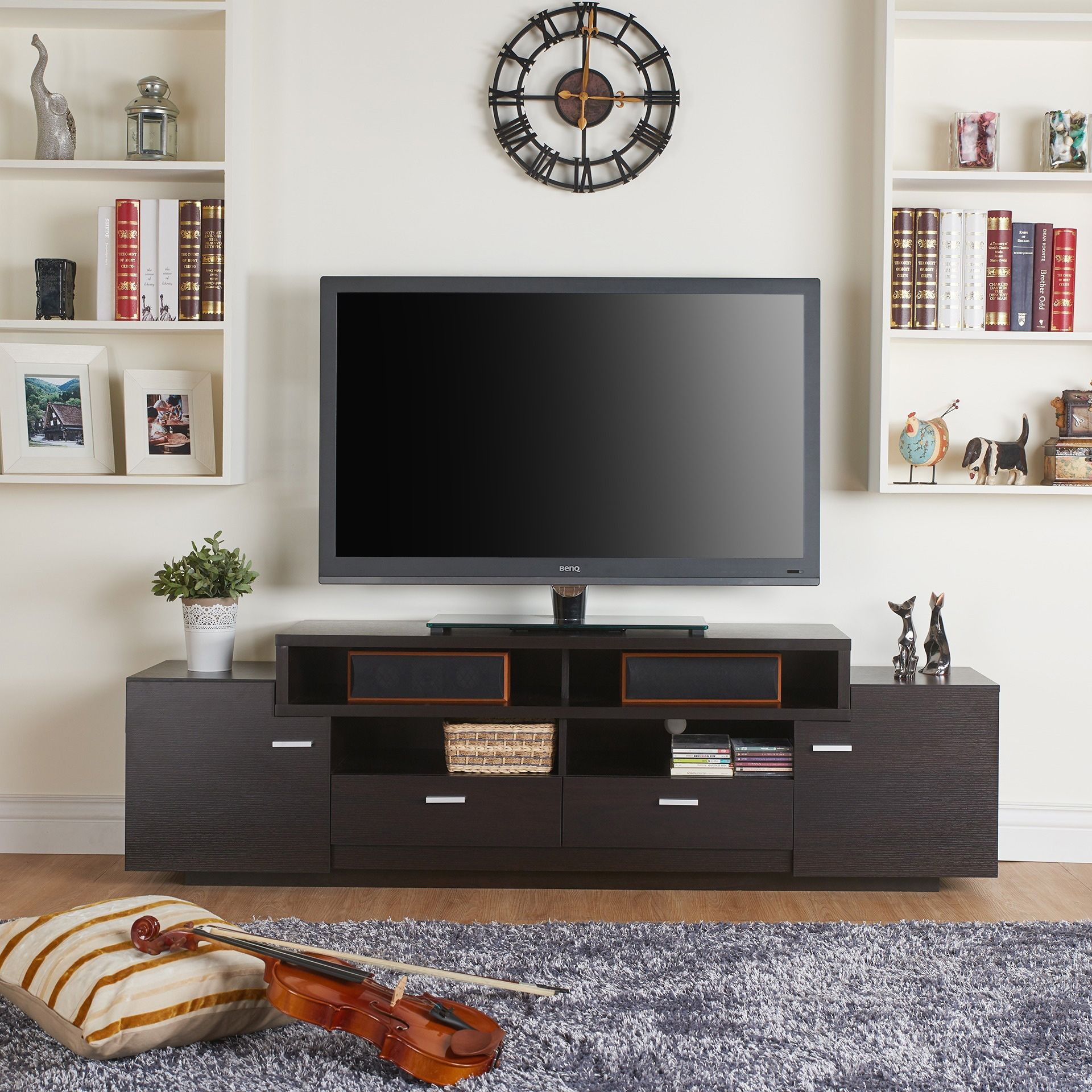 Available in two finishes, this 72-inch TV stand is a sure fit for ...