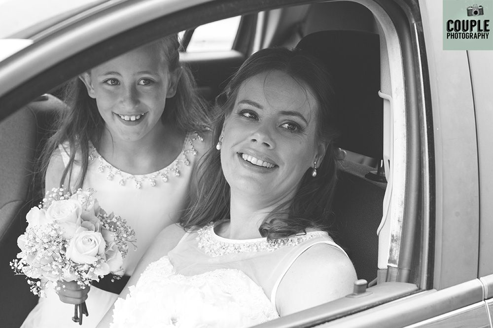 The bride & her flower girl arrive for the ceremony. Weddings at Conyngham Arms Hotel, Photographed by Couple Photography.