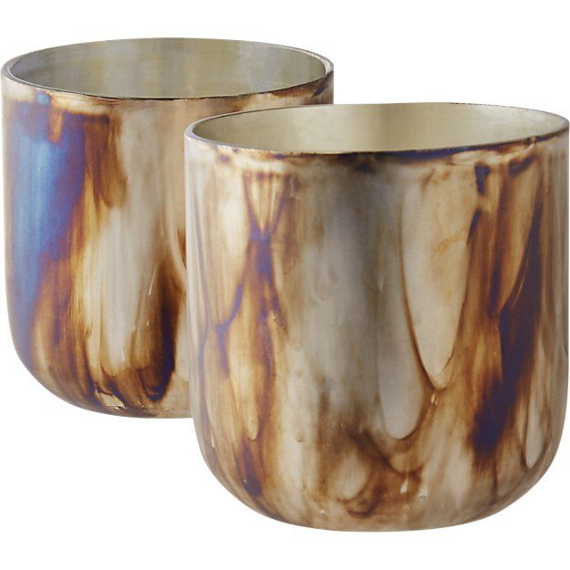 Shop watney brown tealight holder.   Handmade from clear glass with a unique twist, the exterior is finished in burnt metal for an aged, patina-like texture.  We love the unique pattern it reveals with the glow of a single tea light candle.