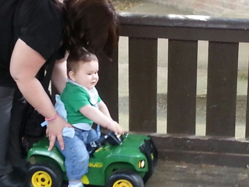 Riding a little tractor