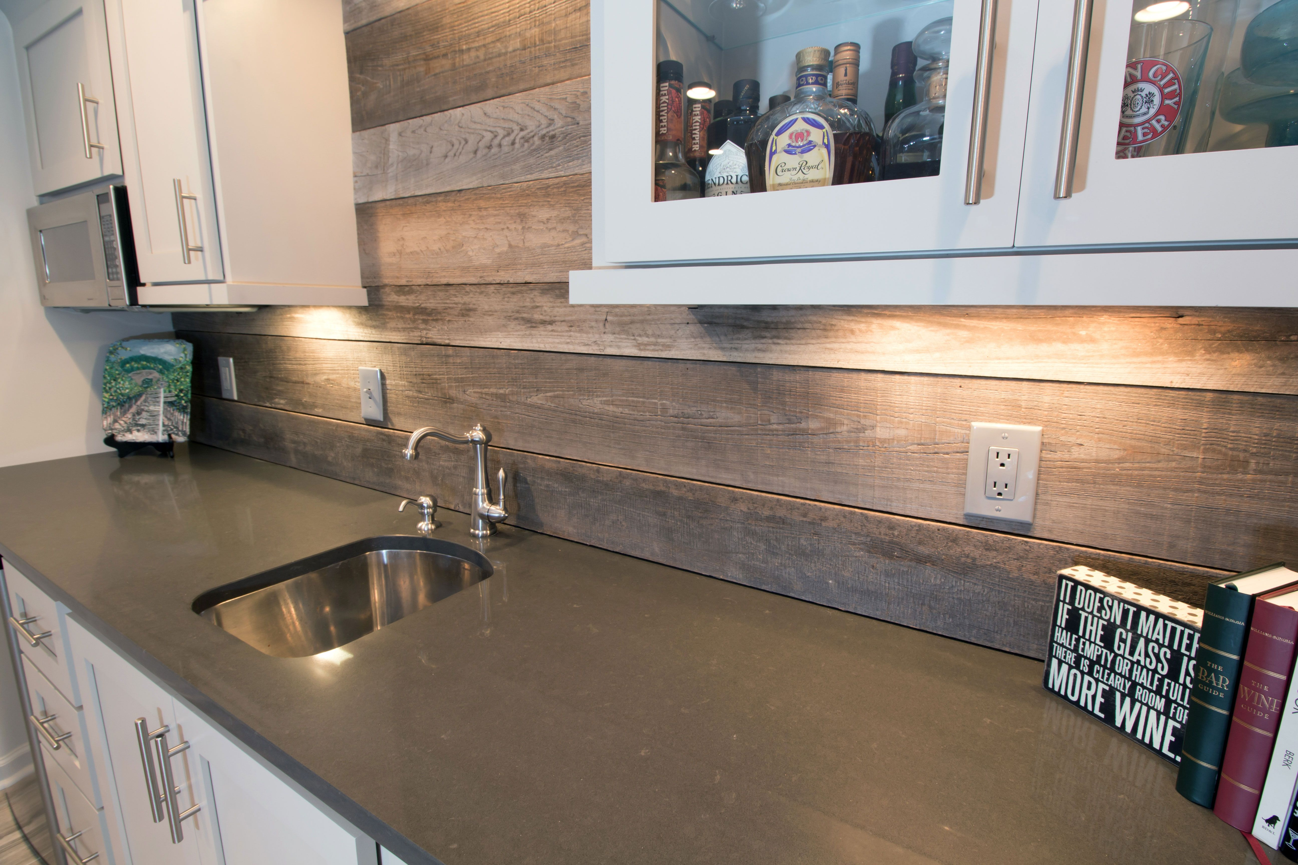 related images. Closeup of back bar with new granite countertops, reclaimed  wood backsplash