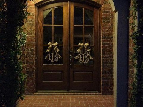 """A nice alternative for doors with windows.  Hang the wreaths in the center of the door rather than from the top.  Perfect for double door front door.  Two 12"""" monograms on wreaths with gold bows.  Very elegant! – The Ultimate Monogram"""