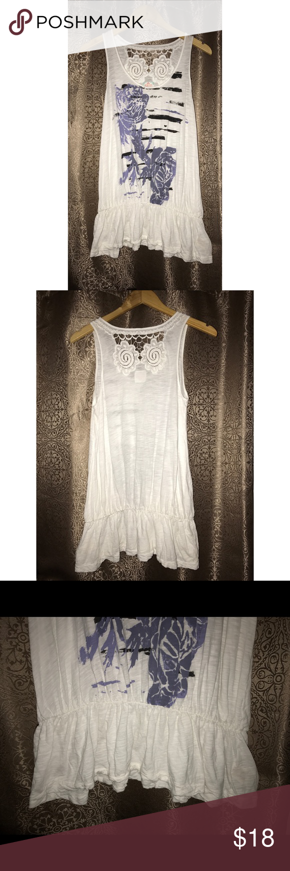 Free People Floral Lace White Tank Top Size Small Pre-owned, in great condition. Free People white and purple floral tee. Lace upper back. Size small. Made in Cambodia. 100% cotton. Free People Tops Tees - Short Sleeve