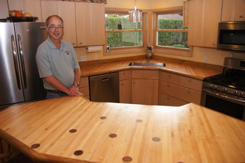 Jim Trussell In His Kitchen That Now Features Recycled Bowling