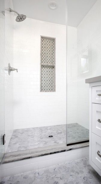 Marble Hex Bathroom Floors Lead To A Glass Shower