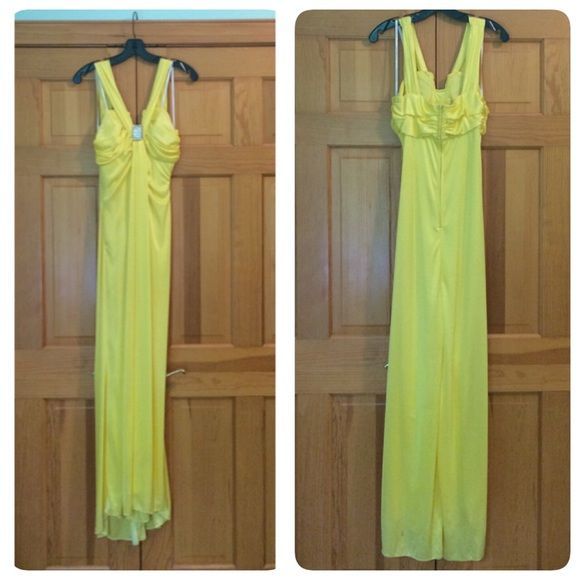 Yellow Prom Dress Beautiful yellow prom dress. Worn once, in good condition. Stain on back, bottom left, should come out when cleaned. Size 7/8. 100% polyester. Feel free to make an offer! Masquerade Dresses Prom