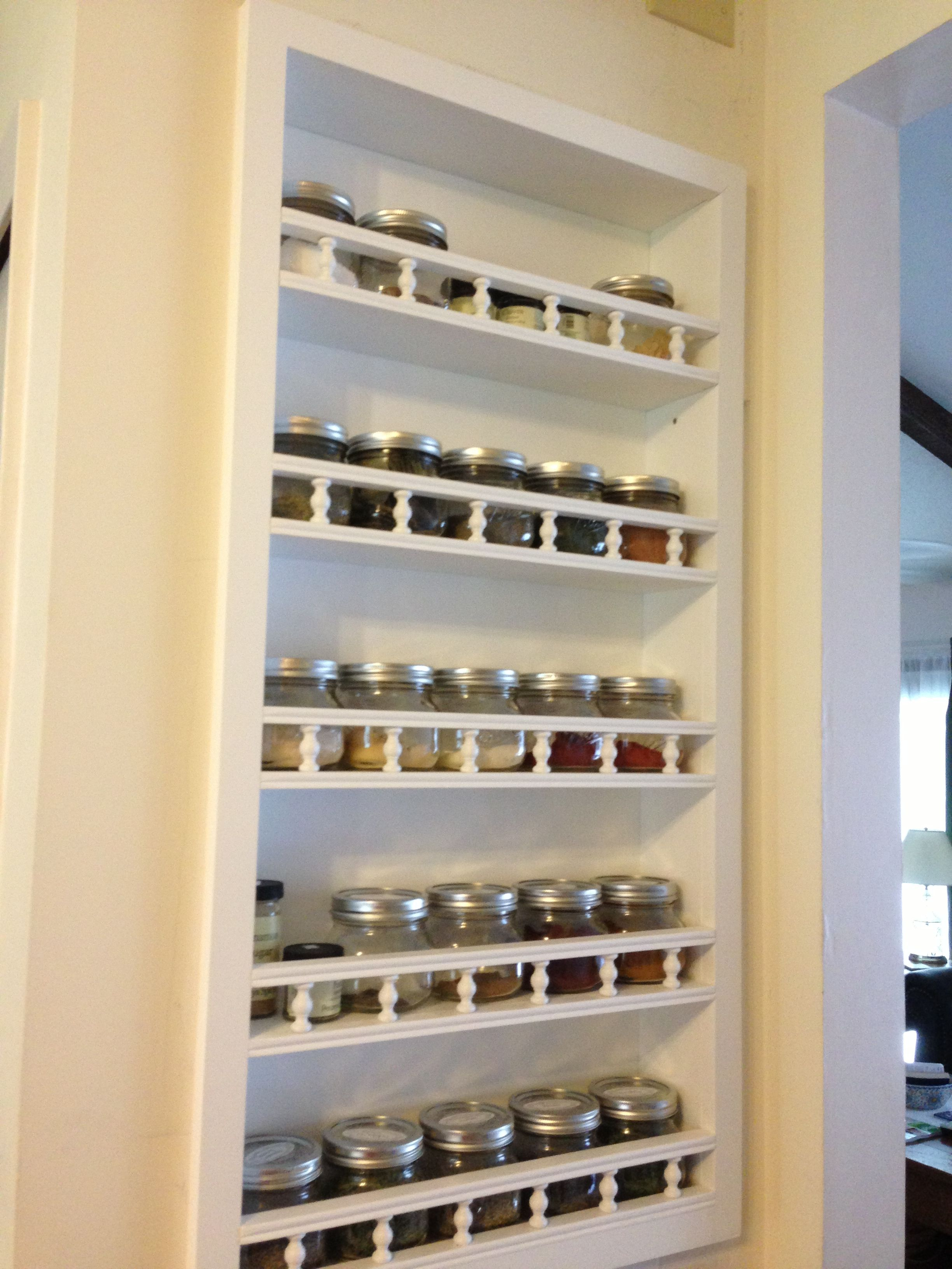 My husband made this built in spice rack to hold my herbs and spices.  I use pint mason jars from the local hardware store and herbs and spices from Penzeys.  :-).   Pantry remodel - exterior