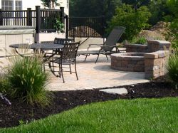 Mulch Installed Around Backyard Patio #mulch #landscaping #hardscaping