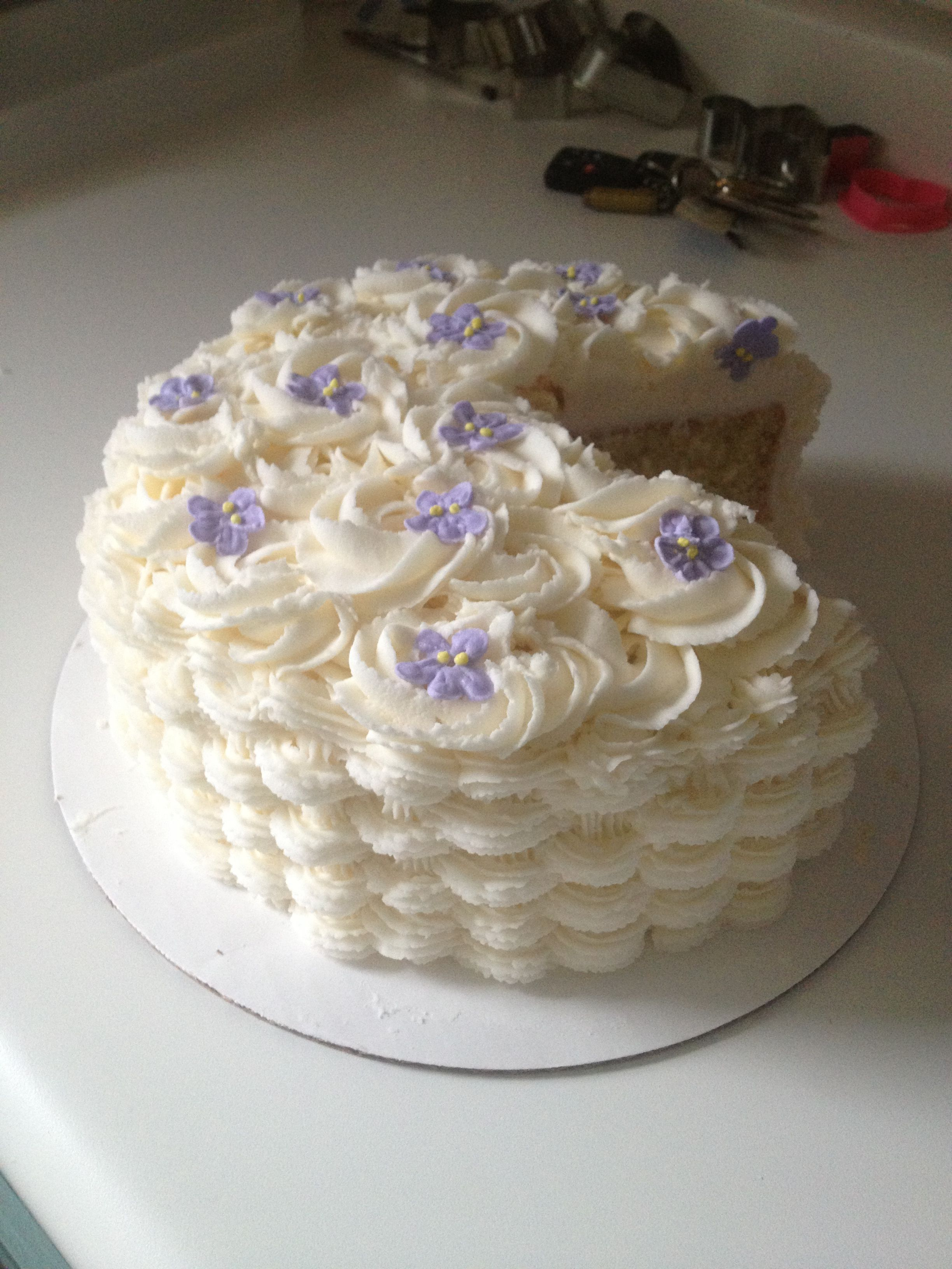 My first basket weave cake with rosettes and violets ...