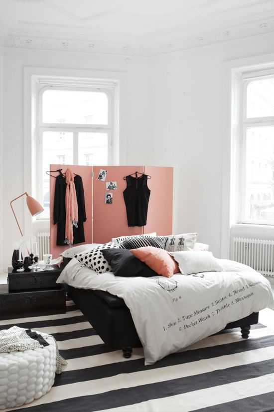 Slide 11 - A white room with black and pale peach decor lends a ...