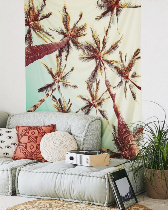 Bohemian cool by Urban Outfitters. Love the 'floor couch' & palm print.