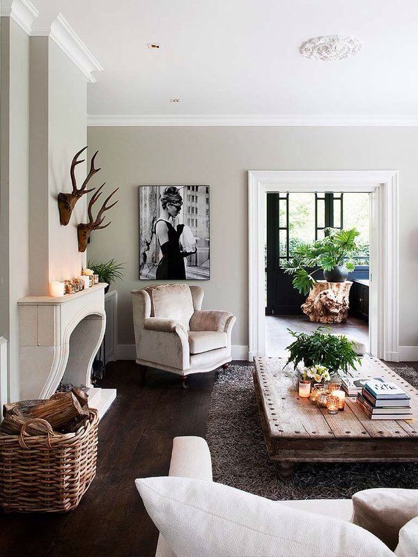 basket for wood - white/cream furniture - rectangle wood coffee table - b&w photos/art - plants in white pots