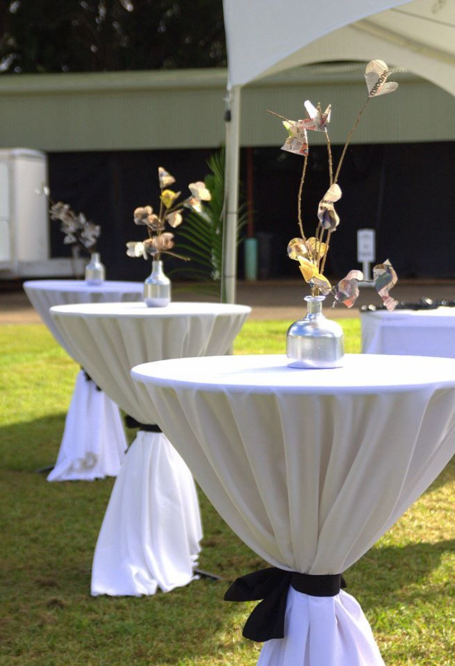 Cocktail Tables With White Linen Tablecloths And Black