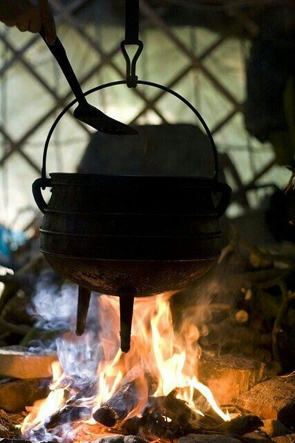 Medieval cooking pot over fire.