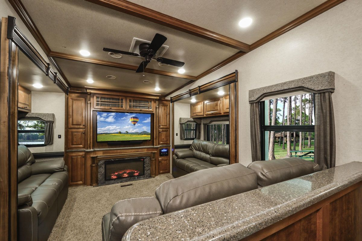Big Country 4010rd S Spacious Rear Den Is Sure To Appease Those Who Love To Entertain Comple Gorgeous Fireplaces Solid Surface Countertops Fifth Wheel Campers