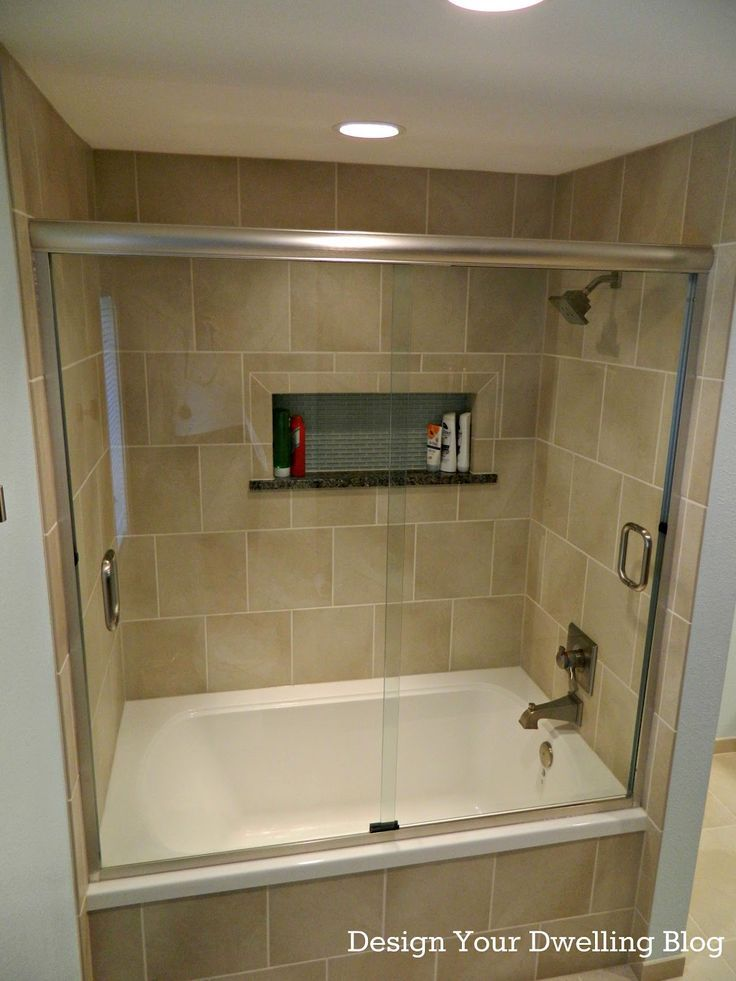 Tiled Shower Tub Combo With Sliding Glass Shower Door This