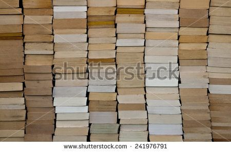 Pile of paperback book ends stacked background  - stock photo