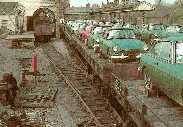 .MG B GT on a train!