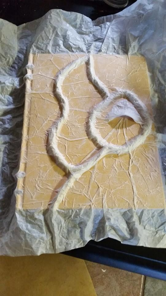 She glues down wads of tissue paper on a Walmart sketchbook, but - halloween decorations for cheap
