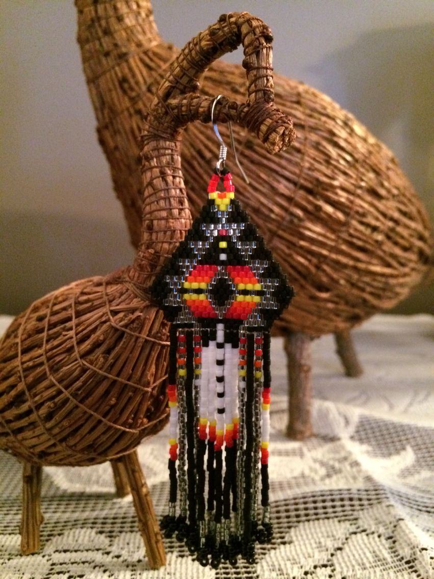 Four Points, NEWS with feather design earrings.