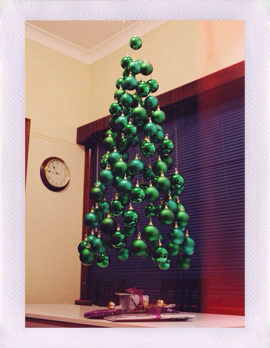 Suspension Christmas Tree Made With Ball Ordimants And Hung From Fishing Wire VERY Cool Idea
