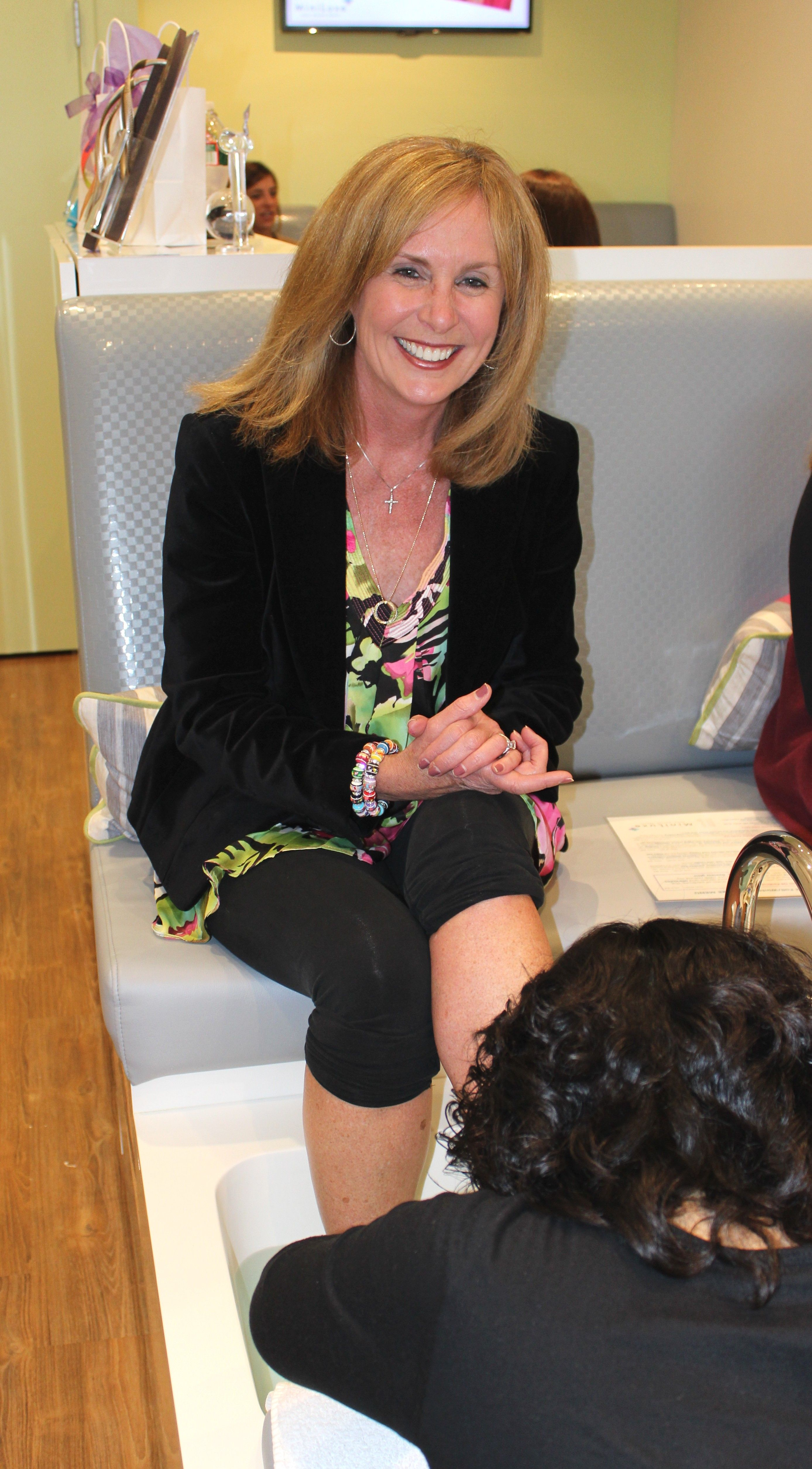 Candy O' Terry from Magic 106.7 getting a pedicure at the Candy O and Friends of Mel event at MiniLuxe in Hingham