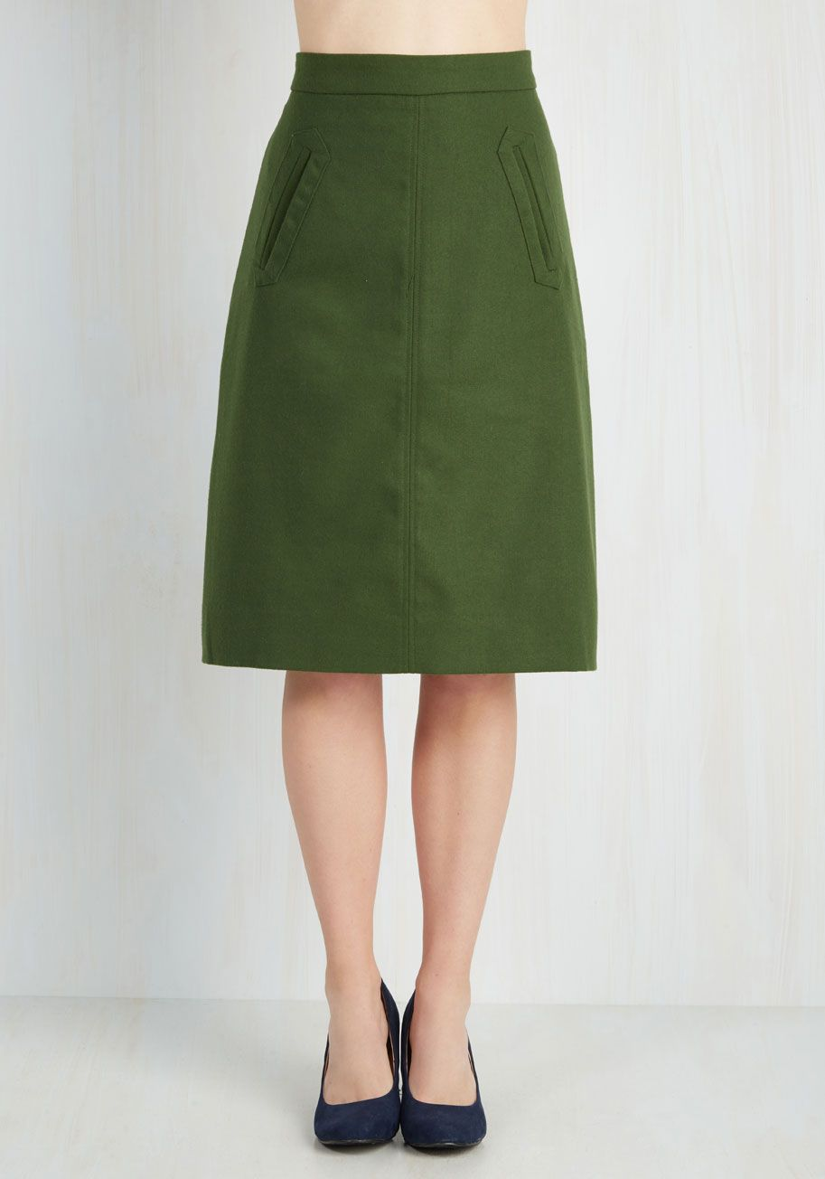 aptitude for aline skirt in forest green taking the podium in this