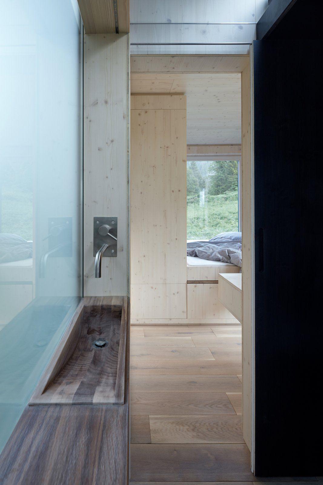 A small walnut washbasin is built into