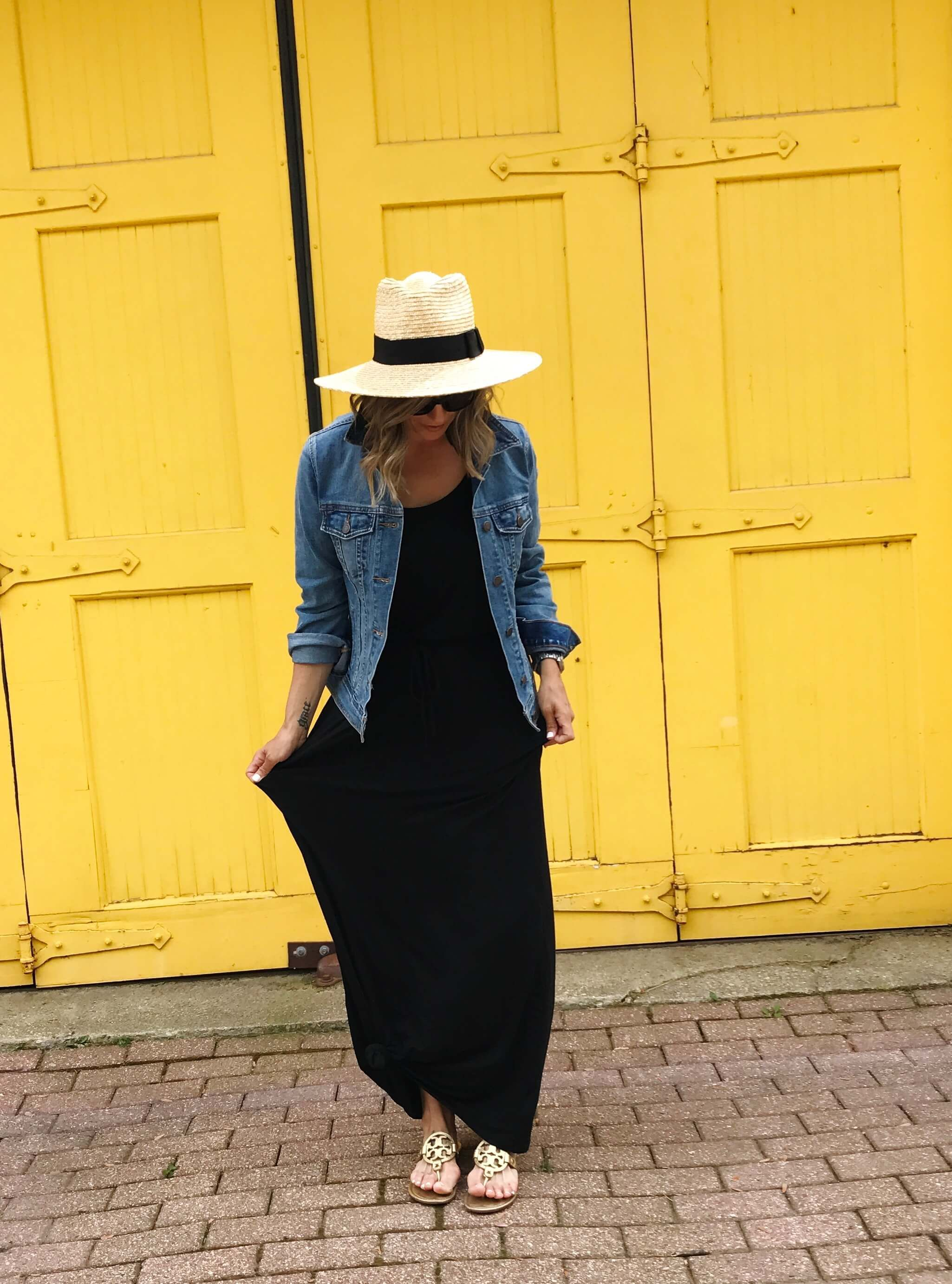 ab0209f617 Easy summer style! A simple black maxi dress and a denim jacket, topped off  with a straw hat.