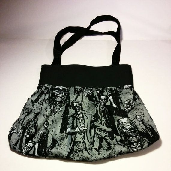 Zombie handbag is made of cotton material and light interface. Each bag is made to order and will slightly vary from picture. Pattern placement