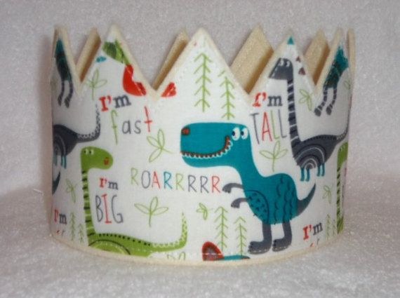 This listing is for one Dinosaur Felt Birthday Crown. Dinosaur Party Play Crown. These crowns are made with 2 layers of eco-fi felt and one layer of Cotton Fabric. They can fit any age from 1 to 100. They have an adjustable back, to make it easy to adjust the size. This crown isnt just for kids...adults love them too.  Crowns can vary from crown to crown based on layout of fabric when making the crown.  Make anyones day a little extra fun with this Crown. Prefect for that Birthday Party, it…