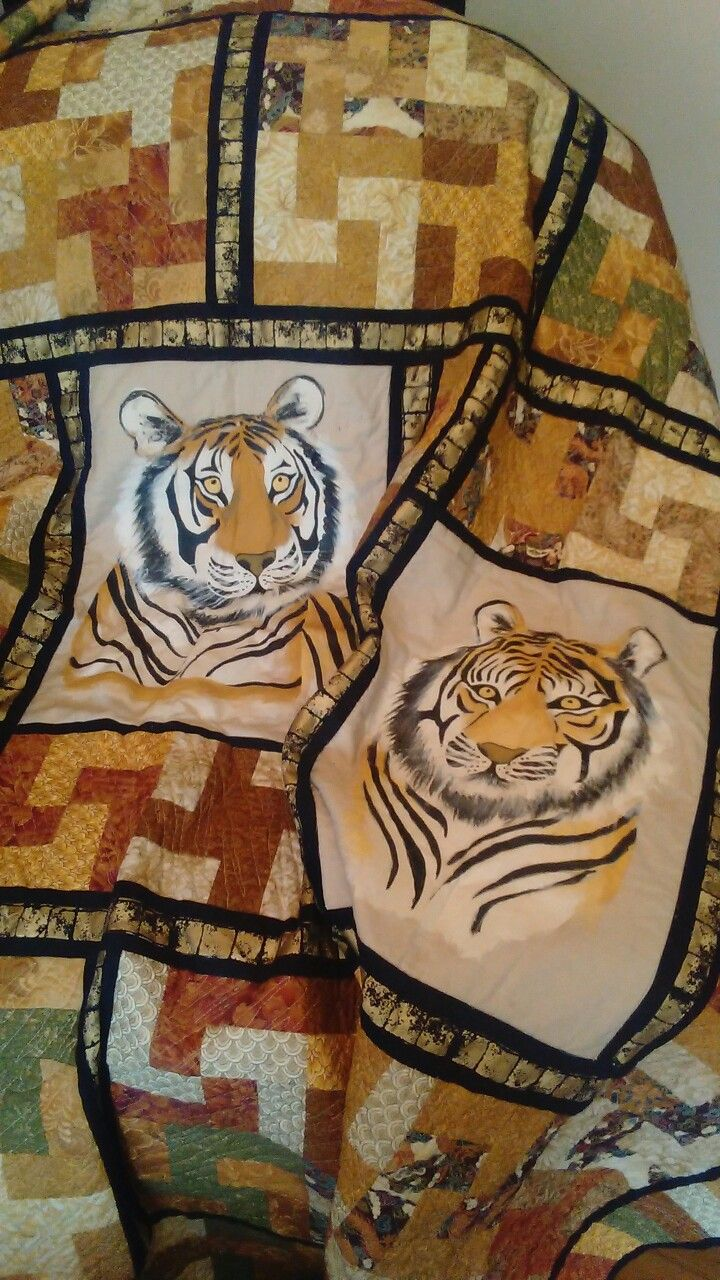 Hand painted Tiger panels. Quilt designed and made by myself about 4 year's ago.
