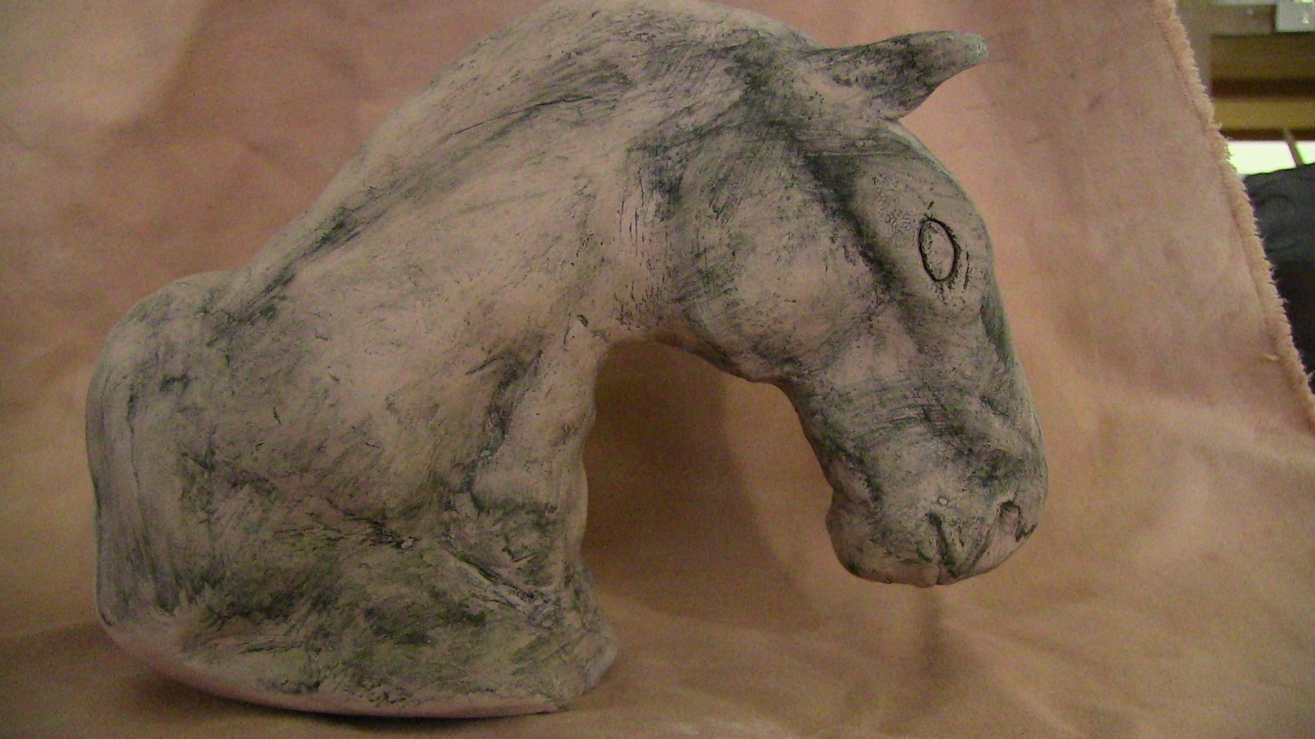 Animal sculpture (horse head). I used the black stain for this and coated very lightly. Since I tried to make this to resemble some ancient sculptures of horses (with mine in mind) I went for a worn down look to make it look older. When I was doing it I was thinking that things dont ware evenly so I should not apply evenly but I think I went a bit too far in that direction and could have applied the stain a bit more evenly. other than that I got what I expected.