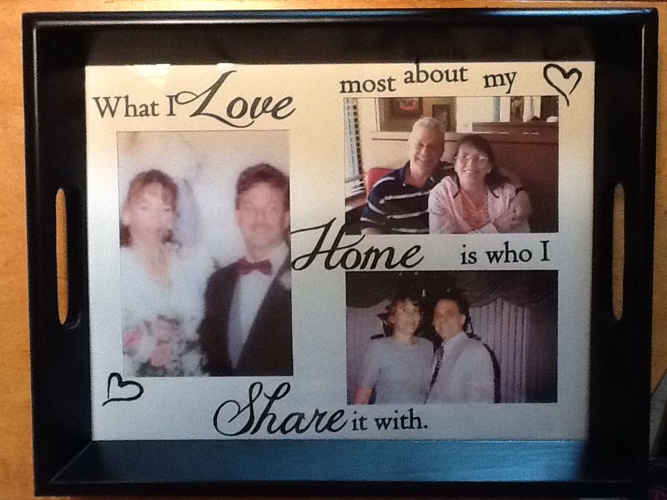 """This serving tray was finished using matting, black vinyl lettering and glass insert. I chose the quote """" what I Love most about my Home is who I Share it with"""" from this quote I chose pictures to complete the serving tray. This is one of my favorites."""