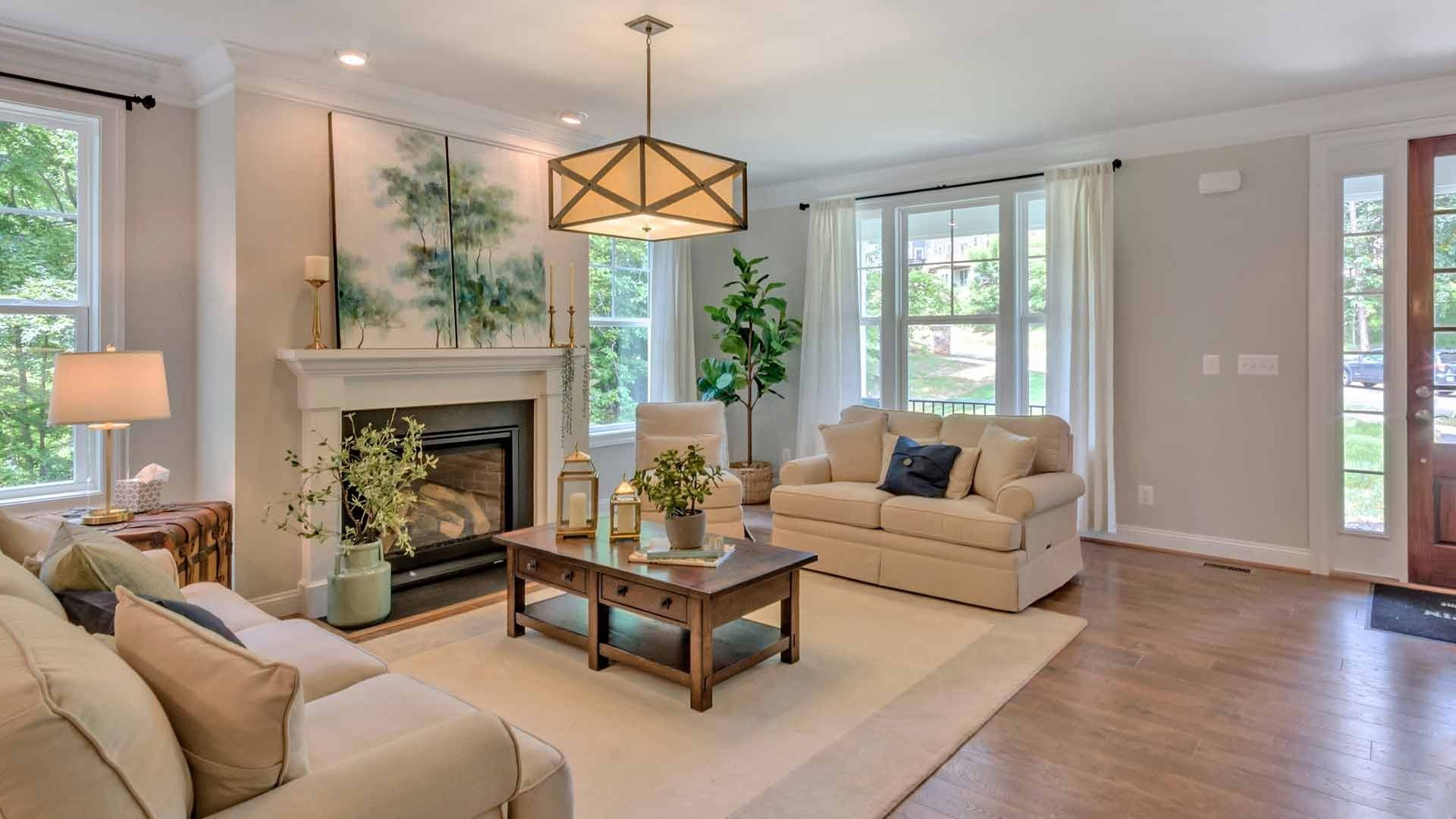 A distinctive light fixture is a focal point in this sunny great room. The Gardiner, a new home by Stanley Martin Homes. The Villas at Belvedere community. Charlottesville, VA.