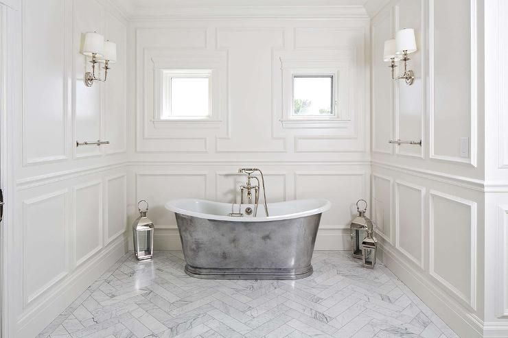 Chic Master Bath Features A Waterworks Candide Freestanding Oval Cast Iron  Bathtub And A Vintage Tub Filler Illuminated By Polished Nickel Lanternsu2026