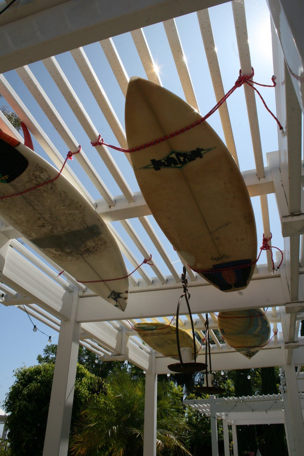 Surfboards hung on our patio