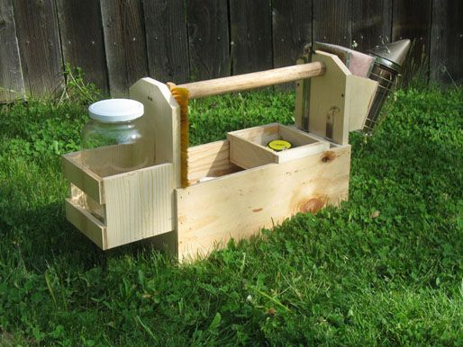 Hive toolbox, including a frame holder on the side ...