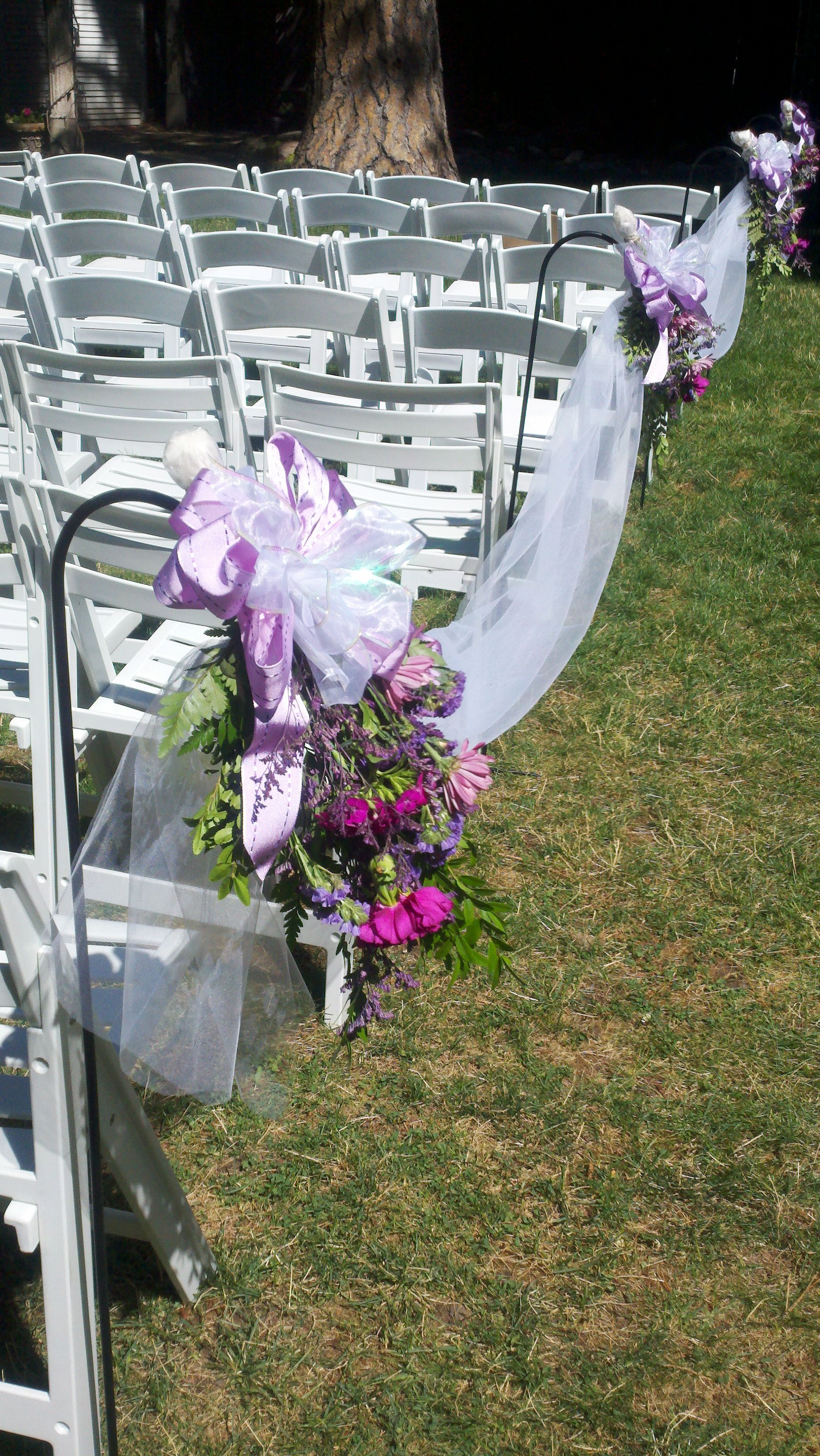 Wedding Flowers On Shepherds Hooks : Shepherd hooks with flowers and fabric to line the aisle