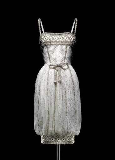 d0ae859f1c1 Yves Saint Laurent for Christian Dior, 1959 Armide tulle short evening dress  with silver sequins. Audrey Hepburn immortalized this dress in a 1959  fashion ...