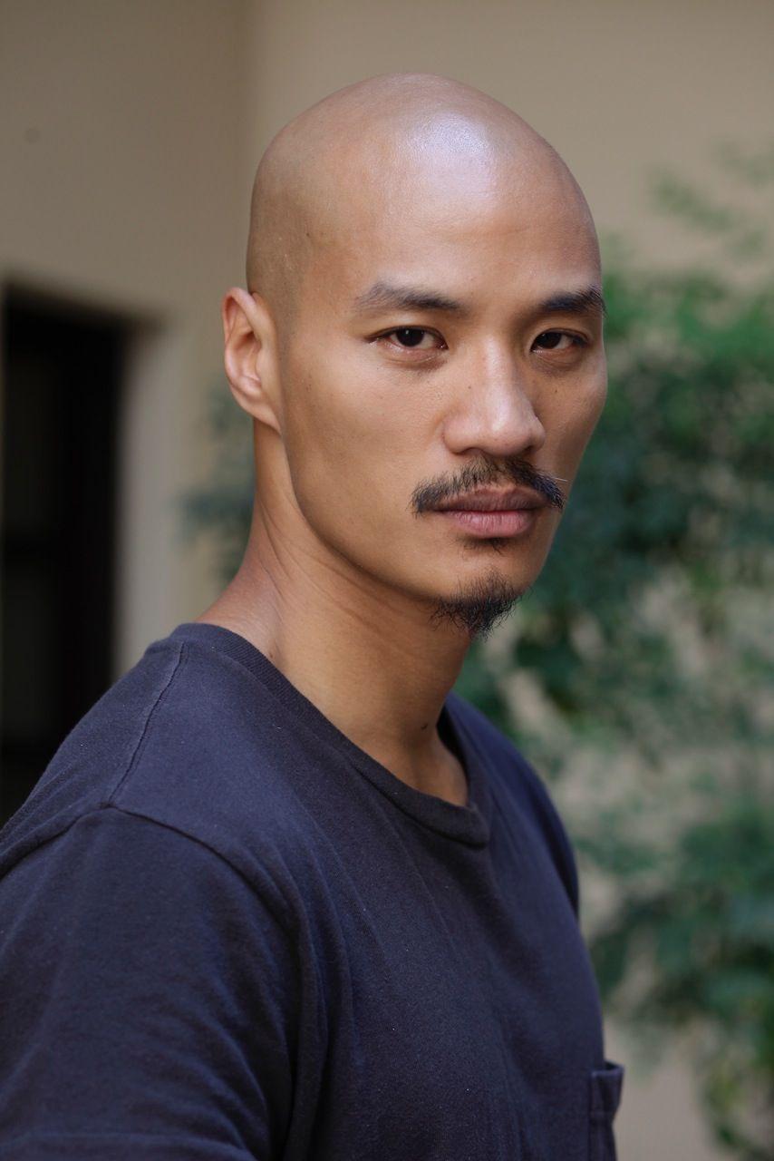 Asian bald guy