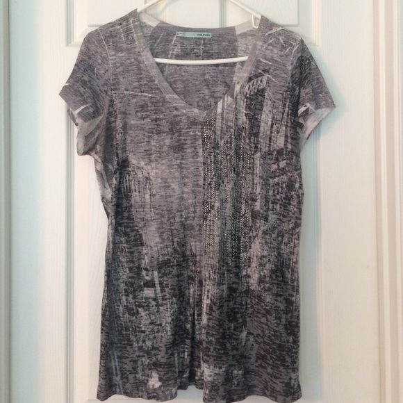 Cute shirt Short sleeved shirt with embellishments. Like new. Maurices Tops