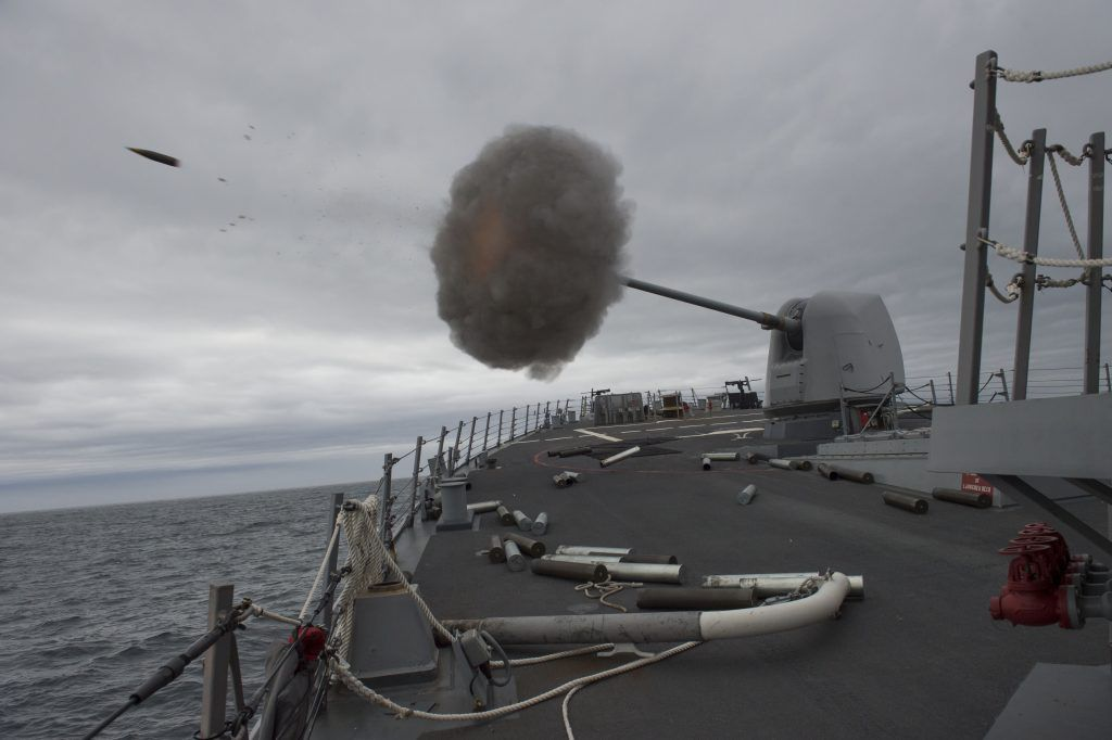 CAPE WRATH, Scotland: A Mark 45 5-inch lightweight gun fires aboard the Arleigh Burke-class guided-missile destroyer USS Carney (DDG 64) as the ship conducts naval surface fire support qualifications in Cape Wrath, Scotland. (U.S. Navy photo by Mass Communication Specialist 3rd Class Weston Jones/Released)