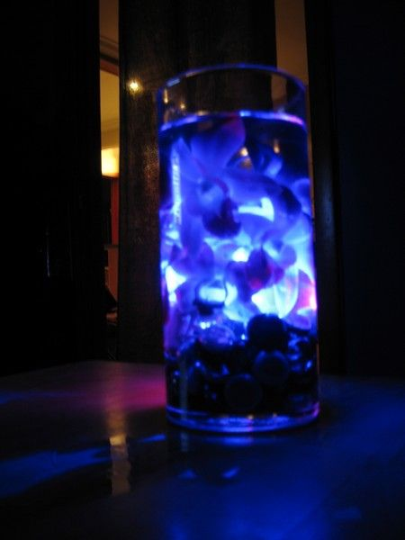 Centerpieces in blue light by gothblossom via flickr