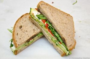 """The SQUASH sandwich from My Belly's Playlist """"Thinly sliced herb roasted zucchini, fresh mozzarella, roasted piquillo peppers, baby arugula, extra virgin olive oil, and a savory house made olive tapenade served on toasted whole grain pan loaf."""" - www.mybellysplaylist.com"""